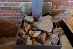 Rocks retain heat and warm up the room